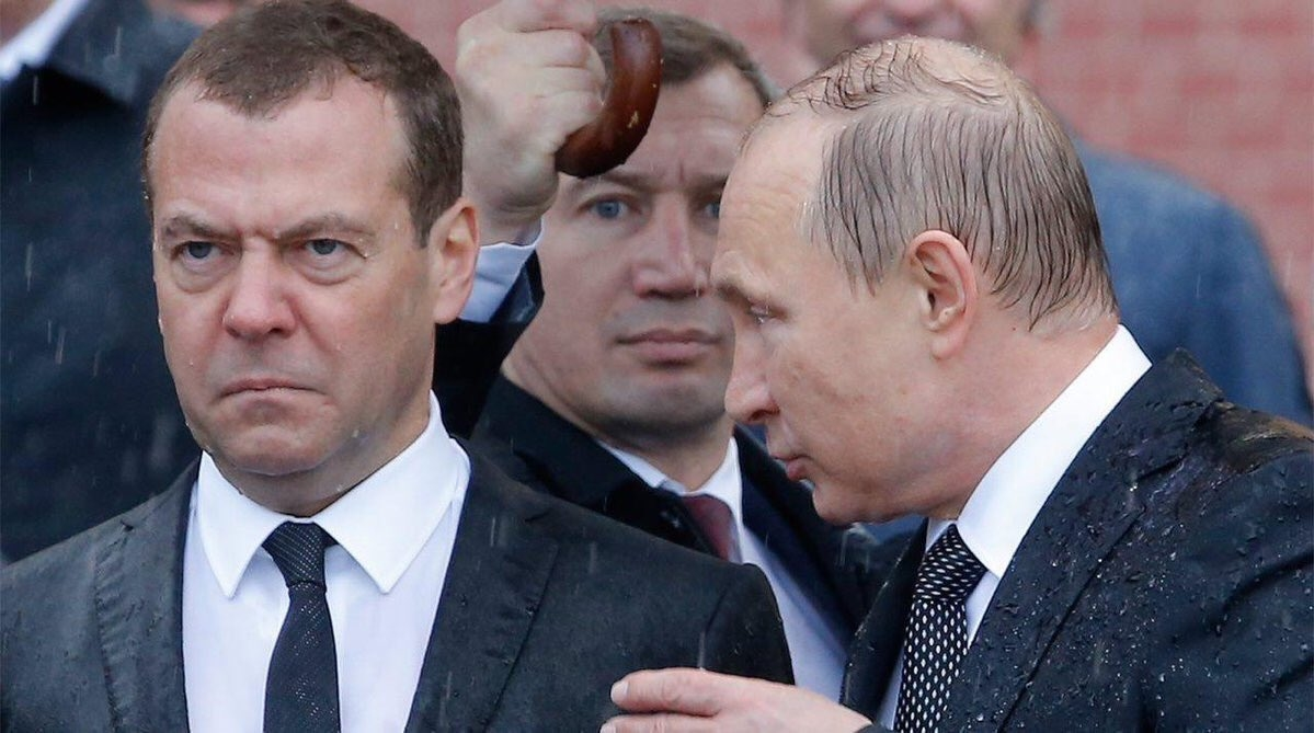 Drenched Putin and Medvedev