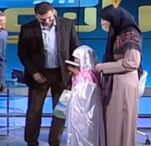 Lebanese Girl Donates Savings To Hizbullah, Rewarded With A Hijab And Copy Of The Quran Signed By Nasrallah