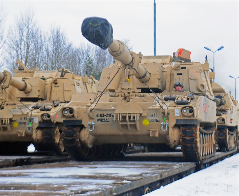 Description: An American soldier from 3rd Battalion, 29th Field Artillery Regiment, 3rd Armored Brigade Combat Team, 4th Infantry Division, drives a M109 Paladin self-propelled howitzer off of a flatcar in Drawsko Pomorskie, Poland, Jan. 9, 2017. The howitzer was one of 53 vehicles that arrived in Northeastern Poland from the Port of Bremerhaven, Germany, as part of Operation Atlantic Resolve. Rotating units through the European theater enhances U.S. European Command's ability to deter aggression and assure U.S. allies. Army photo by Staff Sgt. Corinna Baltos
