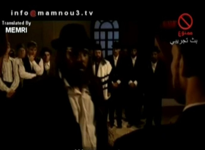 "Ramadan 2005 TV Shows - Al-Shatat: Jews Ritually Murder a Congregation Member Who Married a Non-Jewish Woman after Trying Him in a ""Talmudic Court"""