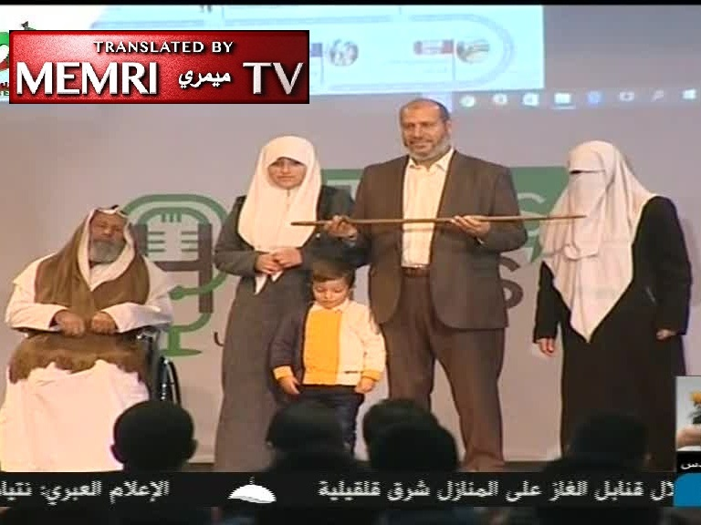 Hamas MP Khalil Al-Hayya Hands His Grandchildren Ahmed Yassin's 'Sword of Liberation' in Ceremony Marking Organization's 29th Anniversary