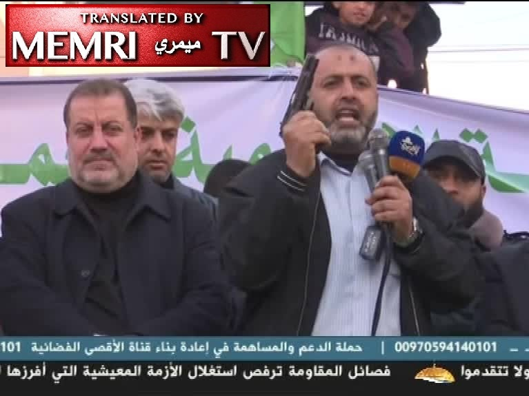 Hamas Official Rafiq Abu Hani Brandishes Handgun and Says to