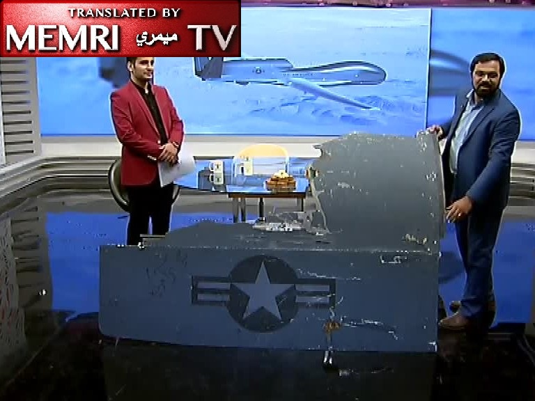 "Debris of U.S. Drone Shown on Iranian TV, Pastries Passed Around Studio to Celebrate the Successful ""Revolutionary Hunting"""
