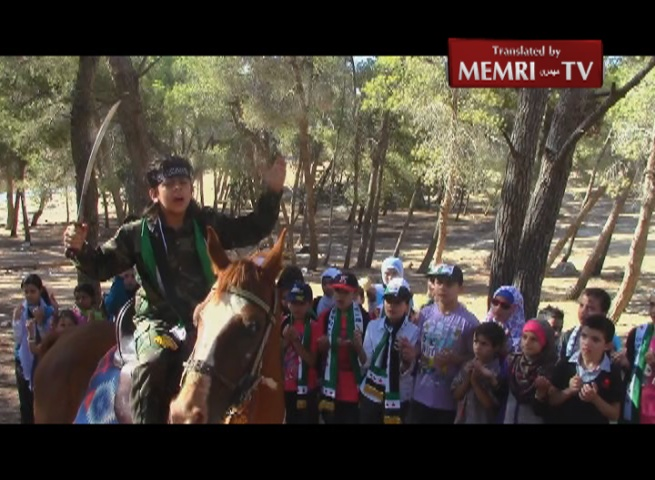 Syrian Boy, Mounted on Horse and Wielding Sword, Thanks Gulf Clerics for Supporting Jihad in Syria