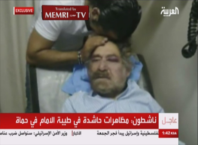 Al-Arabiya TV Airs Exclusive Footage of Syrian Political Cartoonist Ali Farazat in Hospital after Being Kidnapped and Beaten Following His Criticism of the Regime