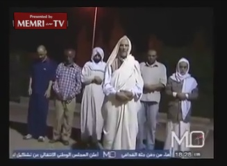 Qadhafi Buried Along with His Son and Defense Minister - Viewer Discretion Advised