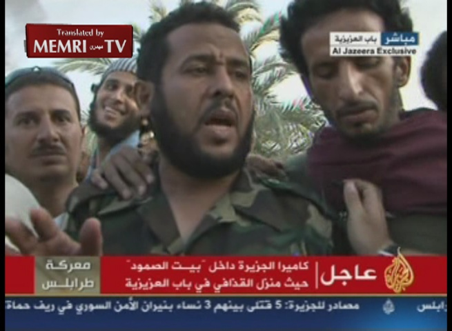 Sheik Abdelhakim Belhaj, Former Emir of Al-Qaeda-Affiliated Group and Now Commander of Libyan Rebels' Military Council in Tripoli, Celebrates Victory