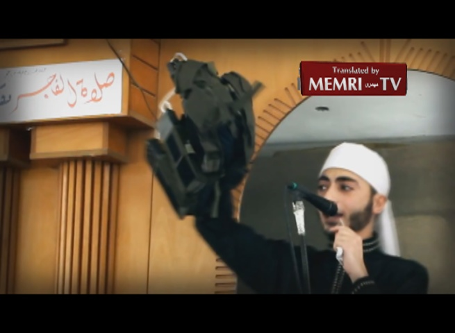 Gaza Preacher Raises Explosives Belt in Friday Sermon: We Will Turn You into Scattered Body Parts