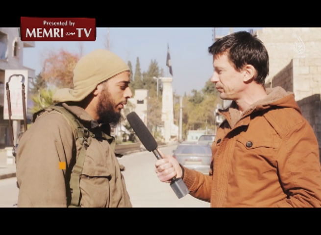 Archival: British Hostage John Cantlie Interviews Top French ISIS Recruiter Salim Benghalem in ISIS Video