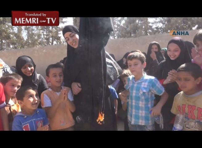 Women Burn Burkas, Celebrating Liberation of Manbij from ISIS