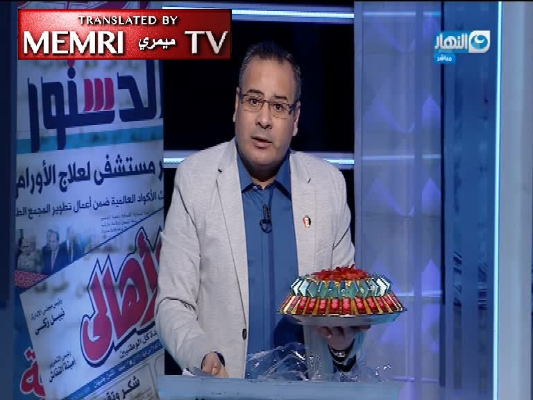 Egyptian TV Host Gaber Al-Karmoty Hands Out Chocolates to Celebrate Downing of Israeli F-16