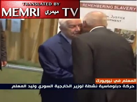 Syrian FM Walid Al-Muallem Exchanges Kisses with Arab League Leader Aboul Gheit during an Impromptu Meeting at the U.N.